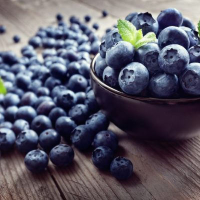 Blueberry antioxidant organic superfood in a bowl on a rustic table concept for healthy eating and nutrition
